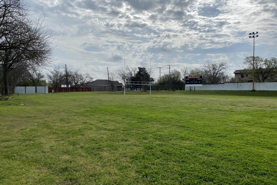FIELD (Before) | It's hard to grasp how large our football field is from a picture, but this photo of the left half of the field is a good place to start! We're putting in turf and renovating the playground area to become a baseball field thanks to our partnership with the Kershaw Foundation!