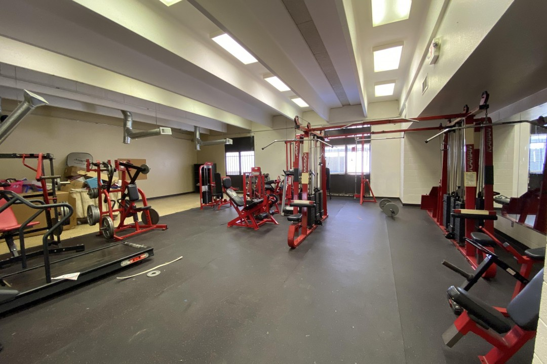 WEIGHT ROOM (Before) | This room used to be the chapel before the independent chapel was built, and now serves as a weight room for members of the community! Think you could keep up with the athletes in our community here?